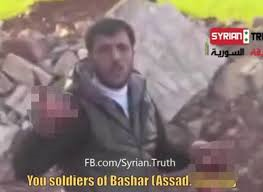 Outrage at Syrian rebel shown 'eating soldier's heart'