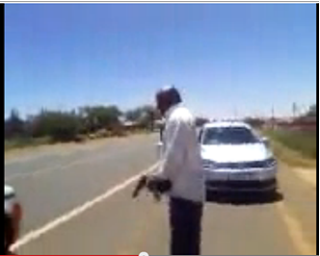 South Africa: Man Points  Gun at Cop in Road Rage